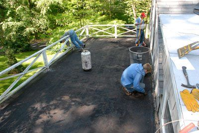 Flat Roof Installation Torch Down- Whether we do a small roof over a garage or a big commercial roof