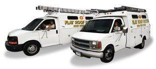 Flat Roof Doctor Trucks - Repairing Flat Roofing