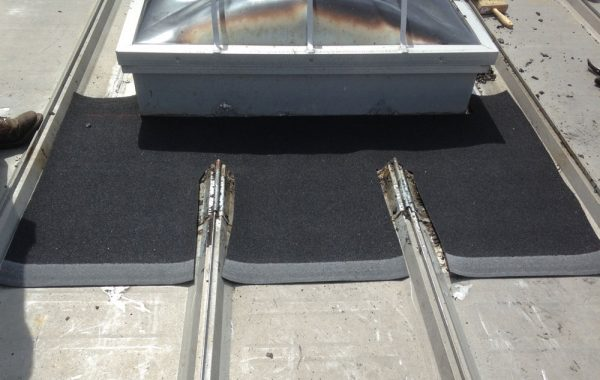 Cut a rubber membrane to size to use as flashing