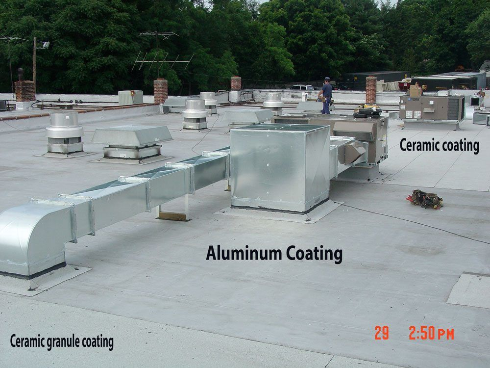 This Torch Down roof is coated with Silver Paint or Aluminum Asphalt Paint