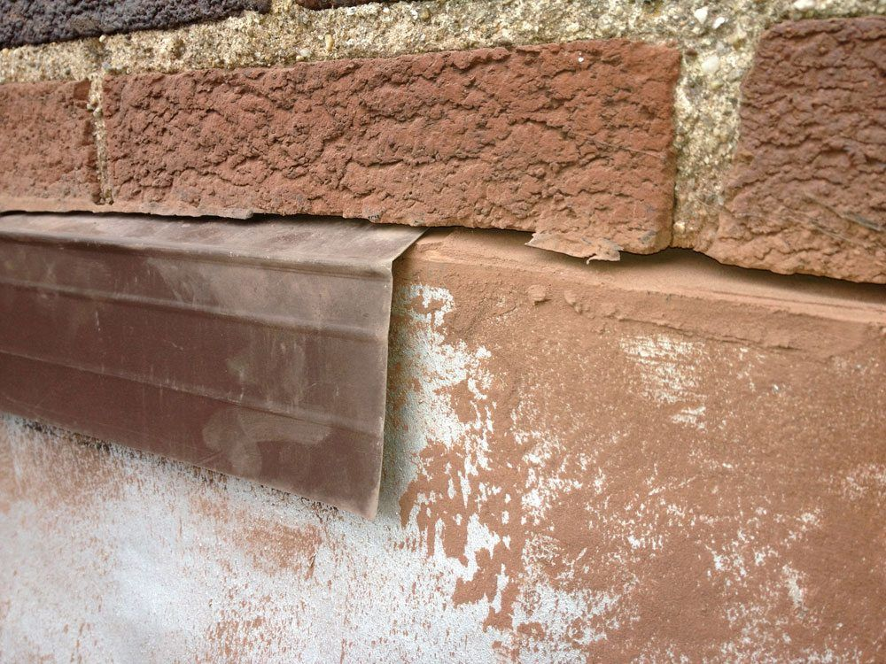 Chimney flashing cut into brick