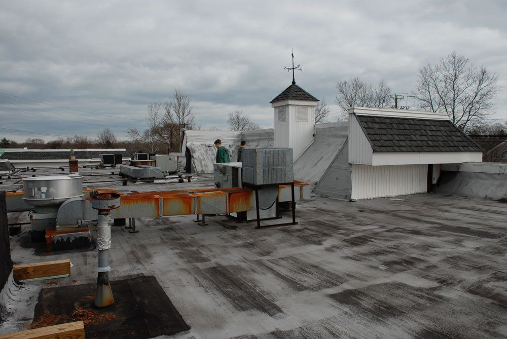 The silver coating or Aluminum Asphalt paint has worn off. This roof is due for a new coating