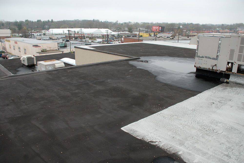 Partially coated asphalt roof - They did not do it to protect the roof but rather to seal against a leak