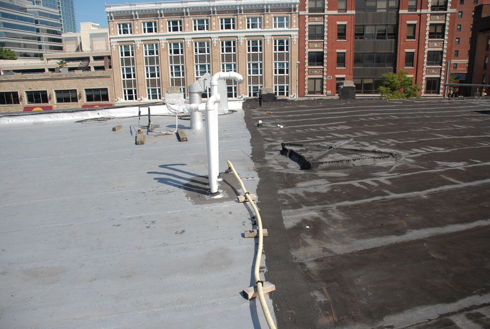 Two identical torch down roofs - One will last indefinitely and the other will need to be replaced in 10 years