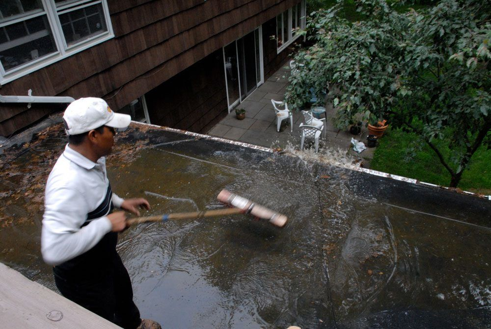 Standing water on an EPDM flat roof- pooling water will disintegrate the adhesives bonding the seams