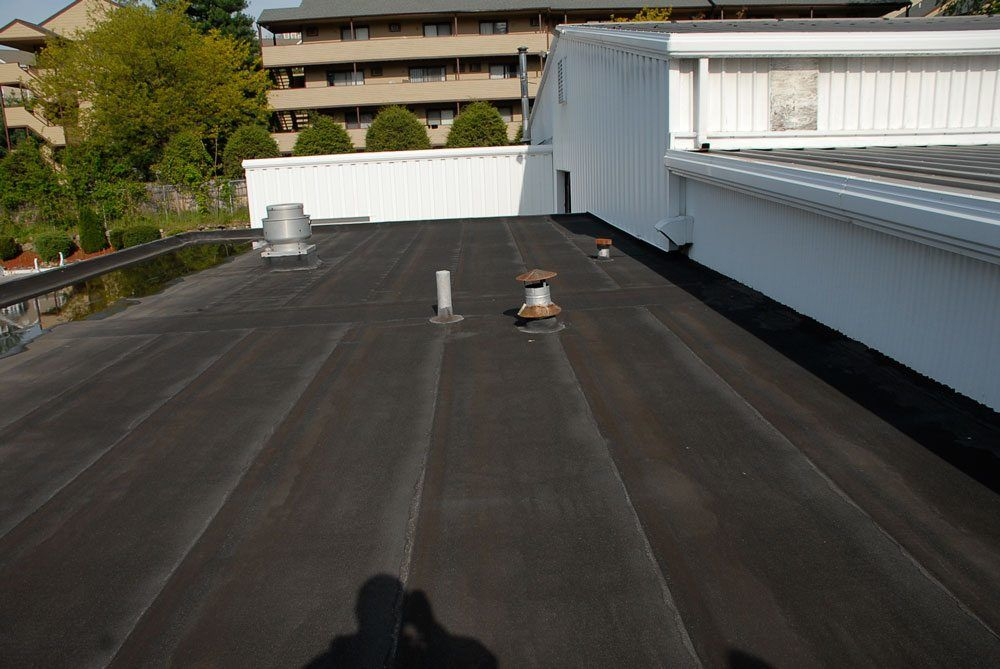 Rubber Roofs Comparing Epdm With Torch Down Video
