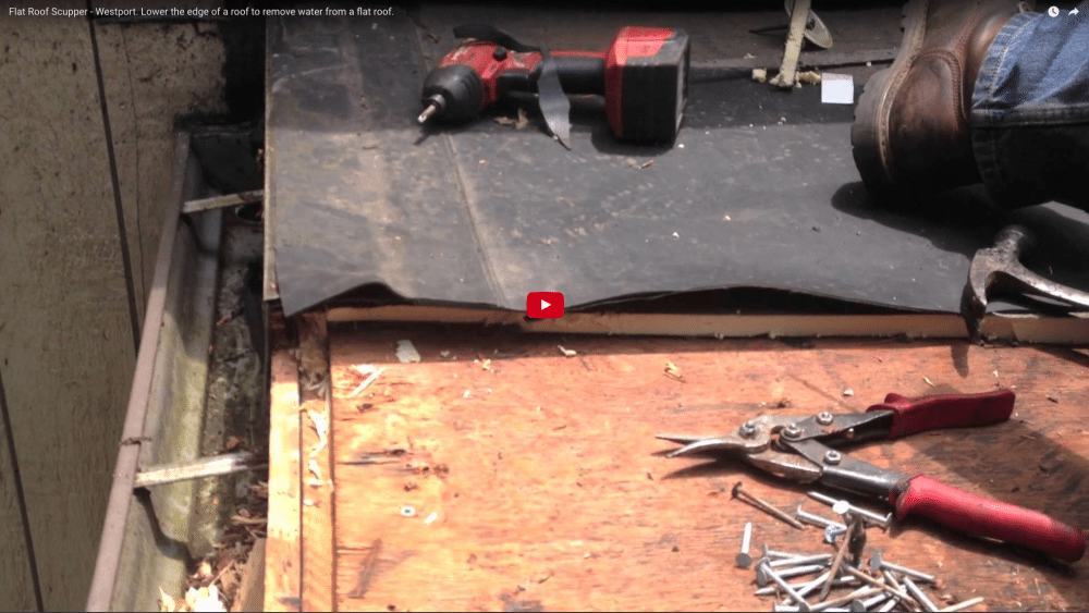 Lowering A Scupper To Remove Water From Pooling On Flat