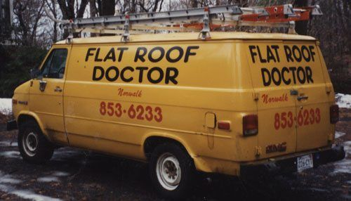 Flat Roof Repair Truck - Latrobe Pennsylvania - PA DIY Roof Fixer guiding you to roof repair