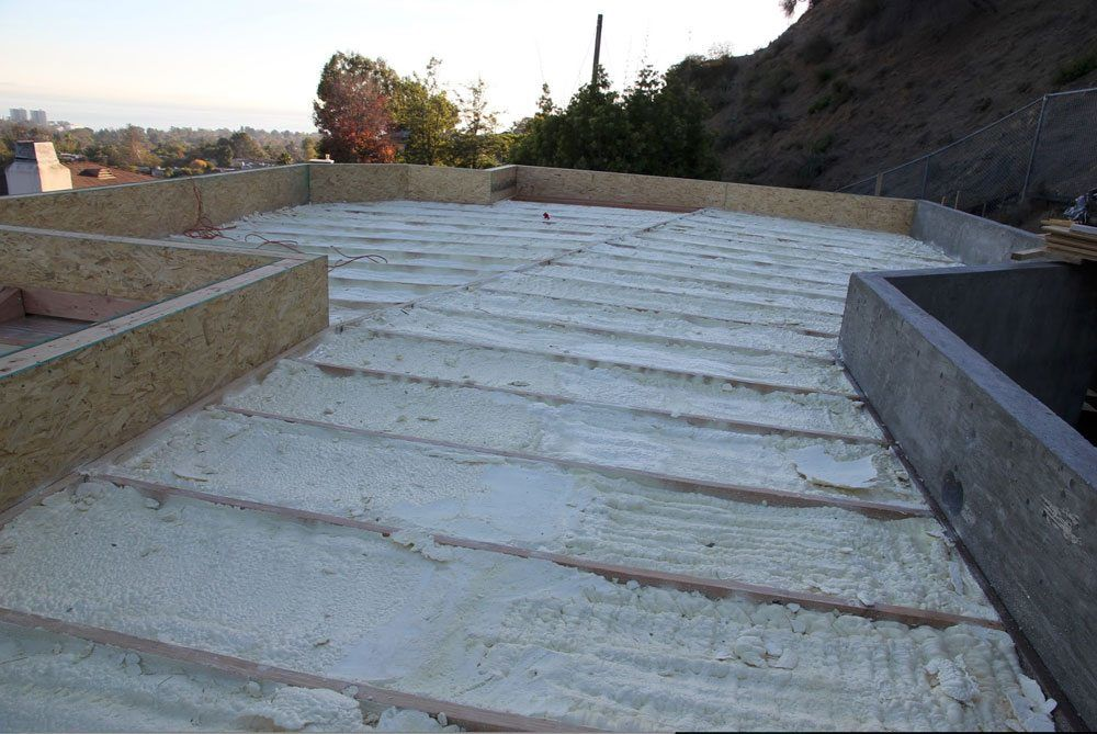 Insulation before the roof deck was installed with closed cell polyurethane spray