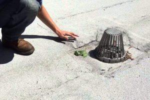 Repairing leaky drains on flat roofs