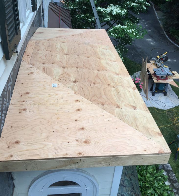 Andre Ferreira Installing plywood on roof