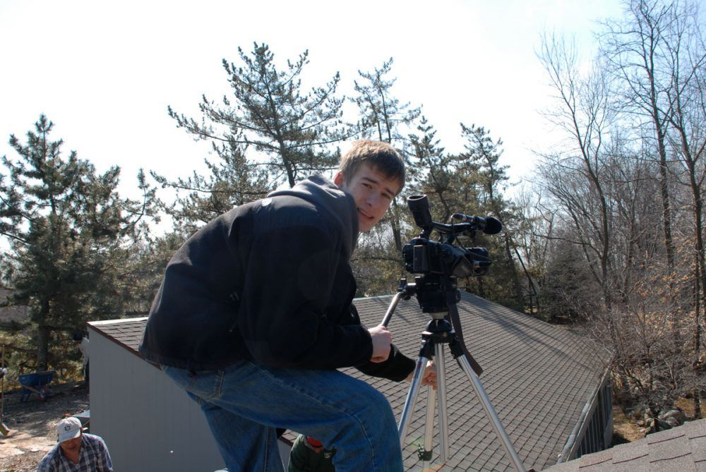Erik behind the camera for videos on a roof