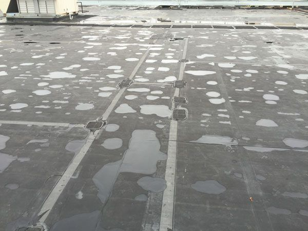 EPDM Membrane roof - Defective Adhesives - Patches on a EPDM rubber roof indicates a premature failure of a roofing system.