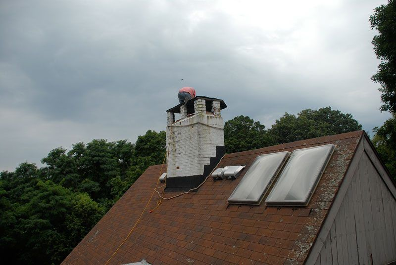 Skylights on a steep high roof - these are very difficult to maintain