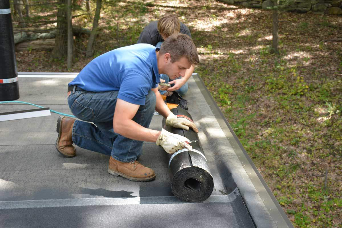Sven Ferreira - installing Two Ply Rubber Roof System