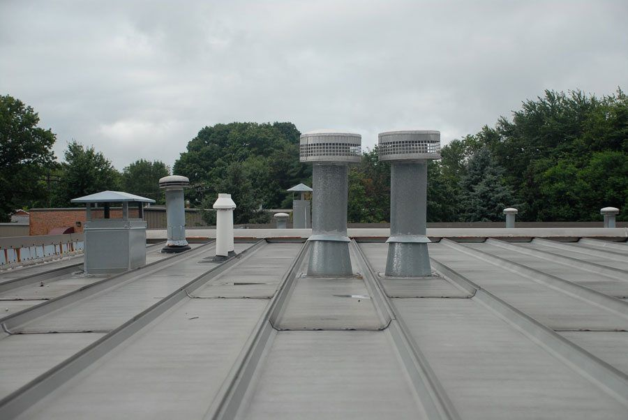 Metal roof recovery. We covered this entire metal roof with a rubber membrane.