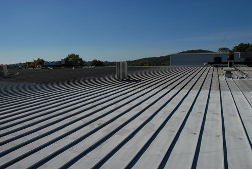 This metal roof was covered with a Modified Bitumen Membrane and the life is extended to another 40 years