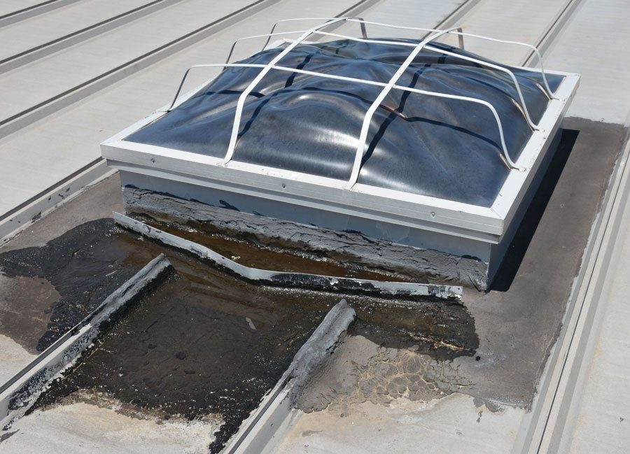 A common material used to repair water leaks, around roof top units, on a metal roof, is tar. This method is very temporary because the tar will dry out and crack very rapidly.