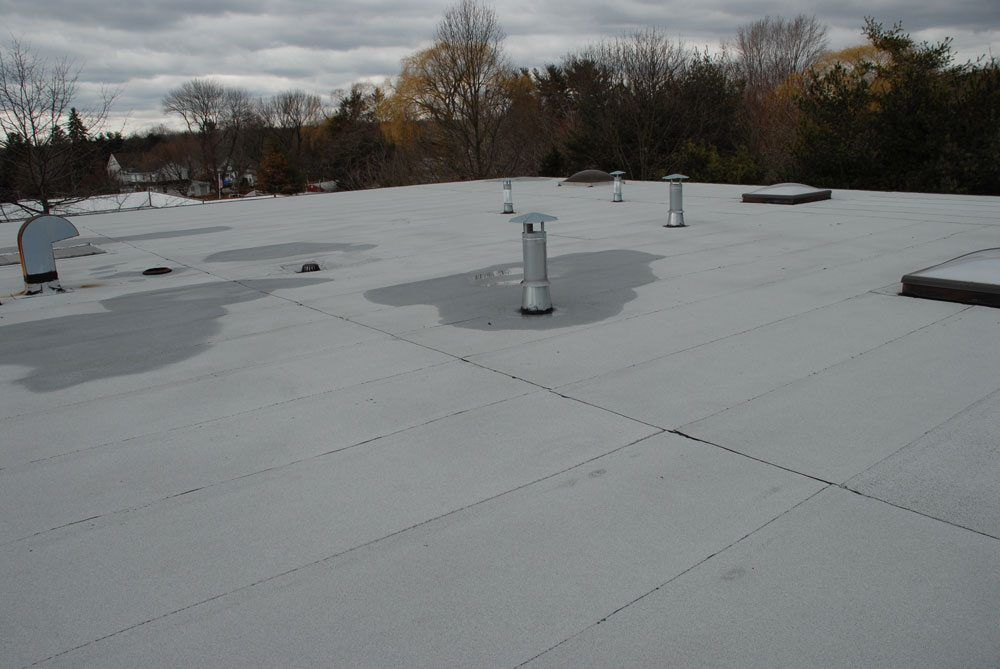 A Rubber Roof Installed over a Tar and Gravel roof - this is the result