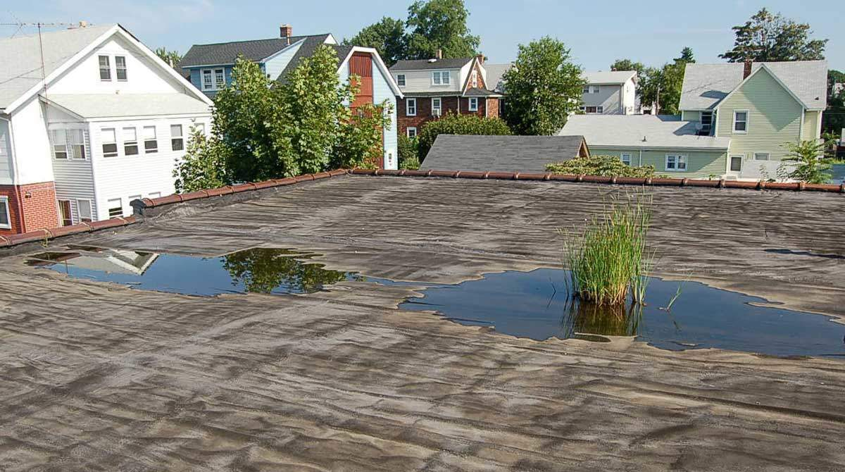 Installing a rubber roof over a gravel roof made easy. Ridgefield, CT