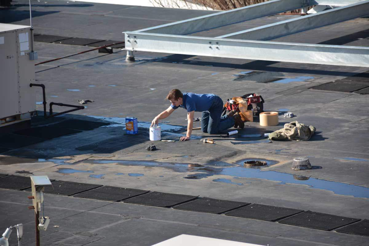 epdm rubber membrane roof being patched flat roof materials - Rubberised Roof Membrane