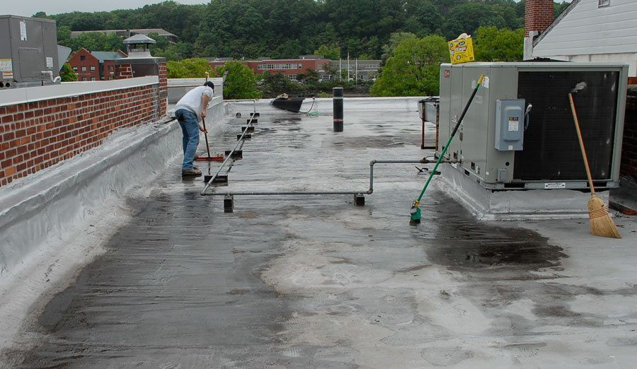 Flat roof repairs on Modified Bitumen Torch Down Rubber Membranes