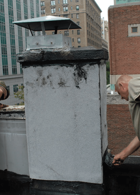 Chimney Flat Roof Leaks - Brownstone Brooklyn and Manhattan chimney transition to flat roof