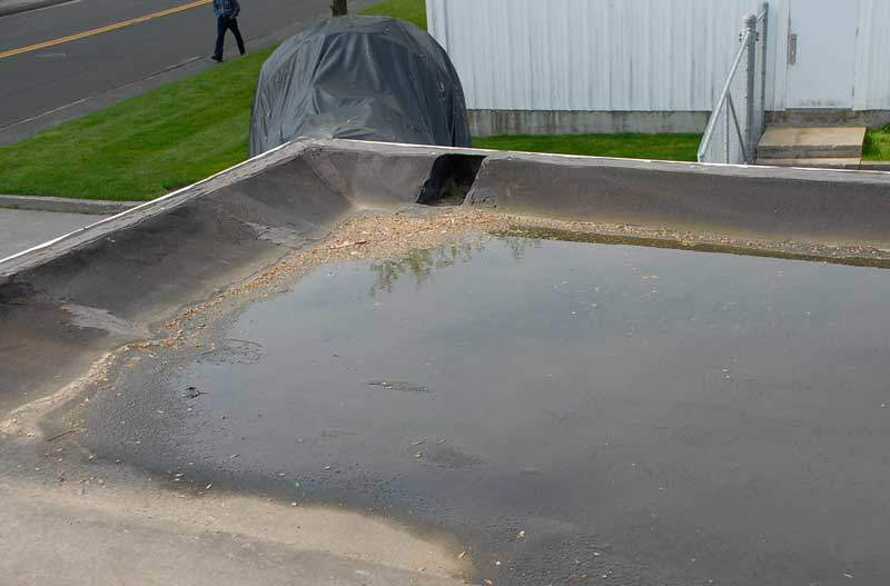 Scuppers Flat Roof Draining - An incorrectly installed scupper causes pooling water.