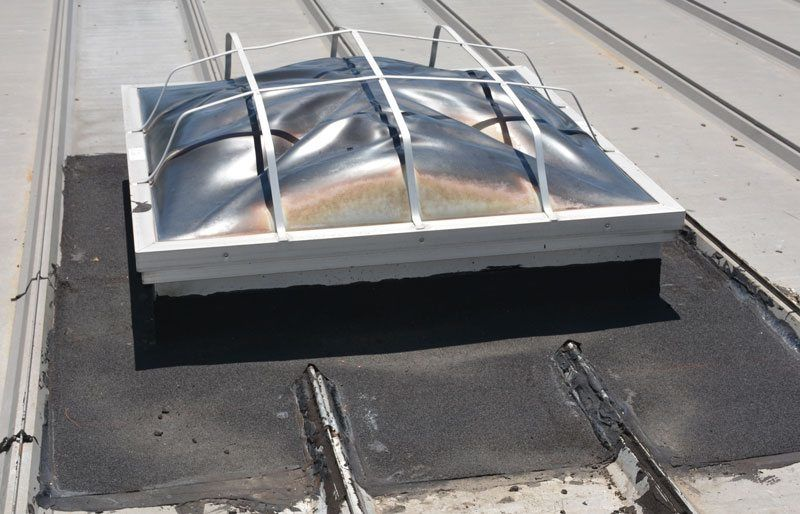 Skylight flashing on a metal roof - unfortunately these skylights need to be maintained periodically