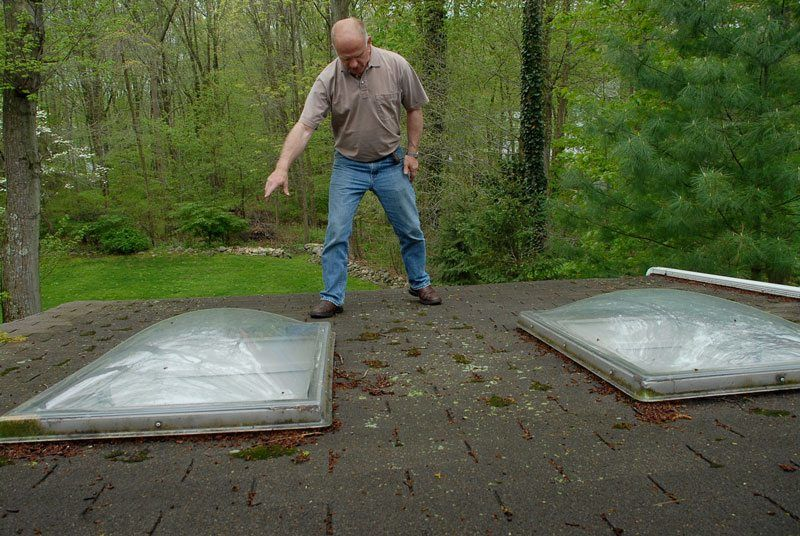 Skylights on a flat roof with shingles - waiting for a disaster to happen