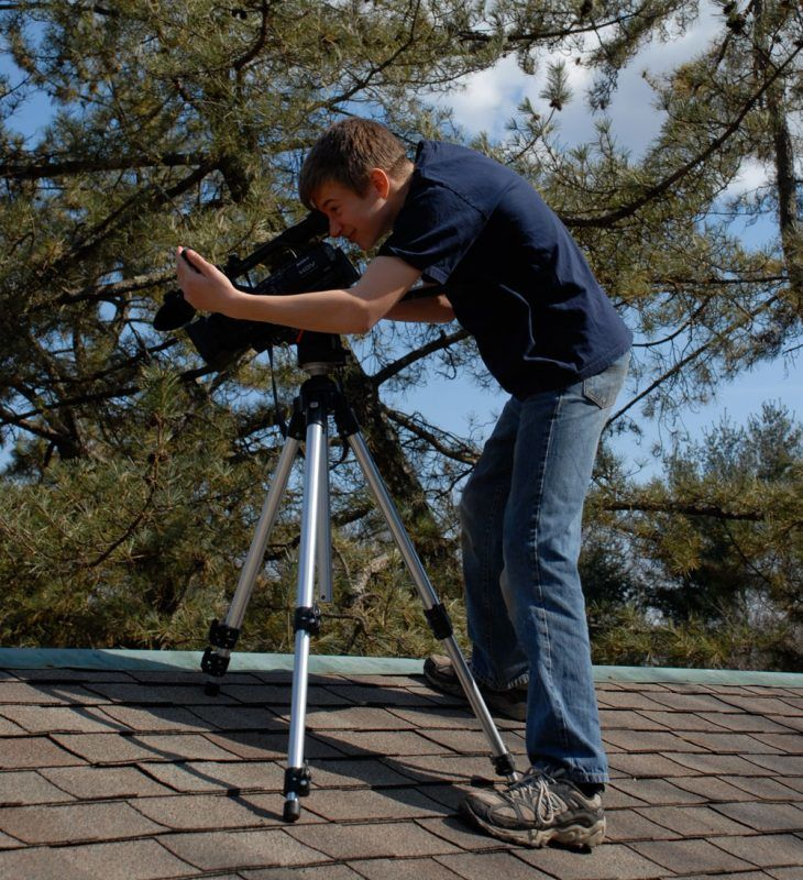 About Flat Roof Doctor - Sven on the camera taking videos of a flat roof