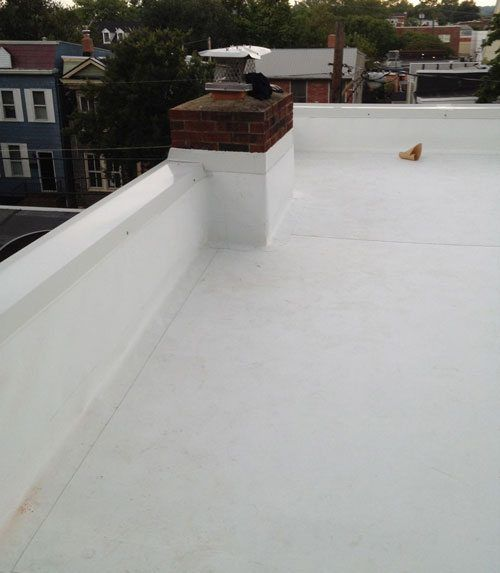 Commercial Flat Roof - A White TPO Vinyl Roof with Little UV Protection.