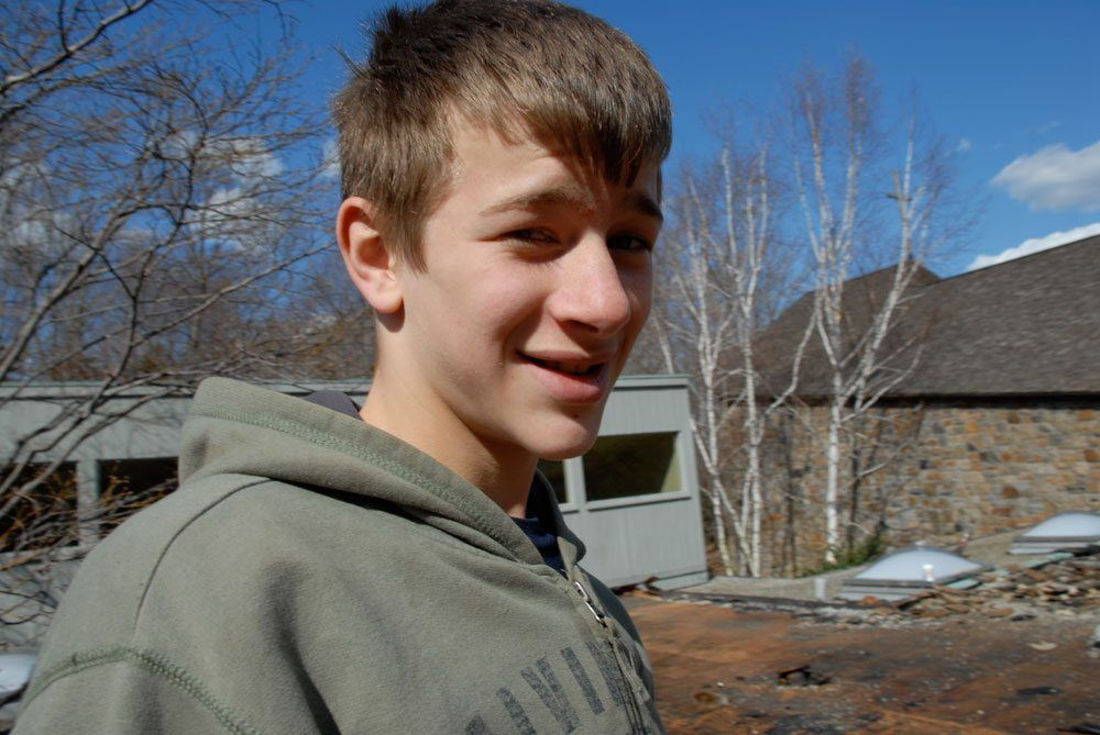 Sven, at the age of 14 taking pictures and videos on roofs we worked on - About Flat Roof Doctor