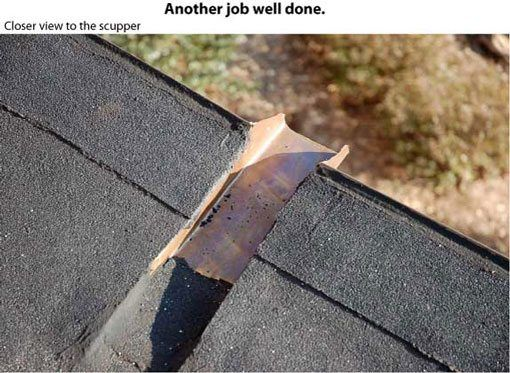 Flat roof repair - A closeup look of the scupper.
