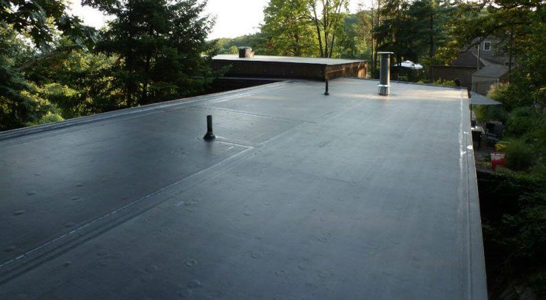 New Canaan, Westport, Connecticut - Flat Roof repairs - This is what a EPDM rubber roof looks like. It is smooth and have less seams. They often need repairs. Flat Roof Repairs - New Canaan, Westport, Redding - We repair all types of flat roofing materials
