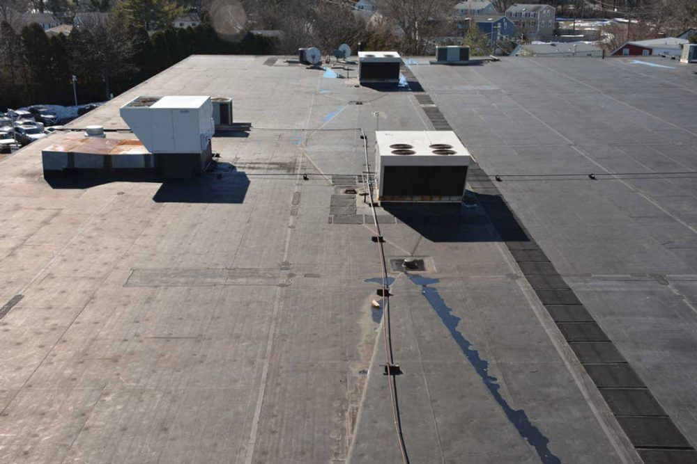 EPDM Rubber on a Commercial roof in Westport CT - The seams are starting to separate due to adhesive failure