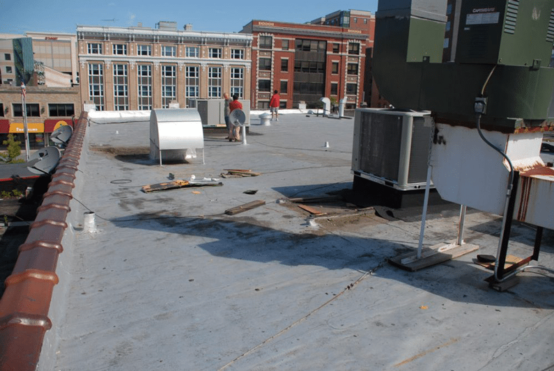 Flat roof Repairs - Modified Bitumen Rubber roofs are the best systems for Flat Roofs. New Canaan, Westport, Connecticut.
