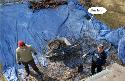 When pitching roofing debris over the side of a roof, it is best to spread a tarp. It makes cleanup much easier. We are the flat roof experts.