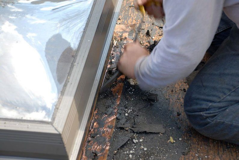 cleaning off the old roofing material from the flashing is the hardest part