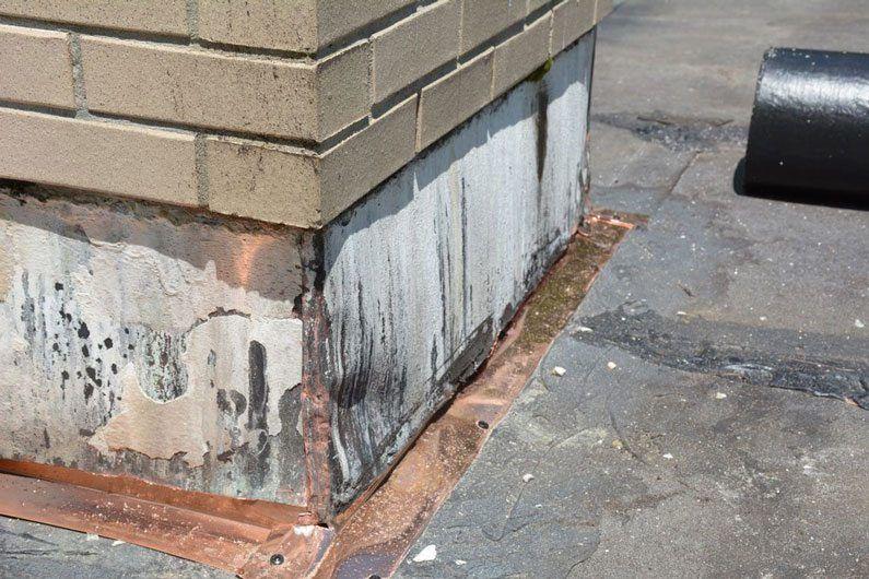 We installed copper flashing around the chimneys