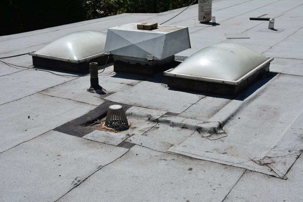 New Drain Lowered Flat Roof Repairs And Installation