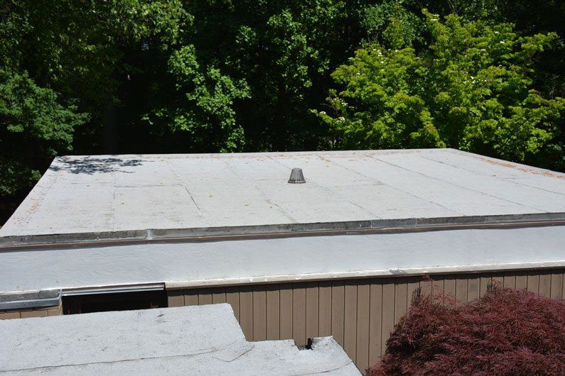 Garage roof with new drain