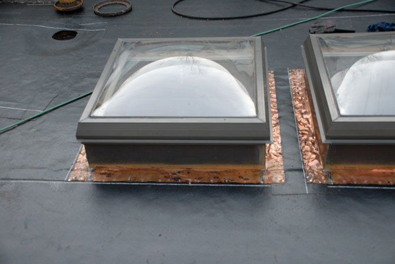 These skylights had the flashing cleaned before a new roof could be installed