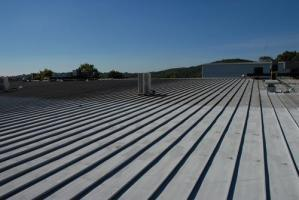 metal roof repair coating extends life expectancy roofing material - Flat Metal Roof