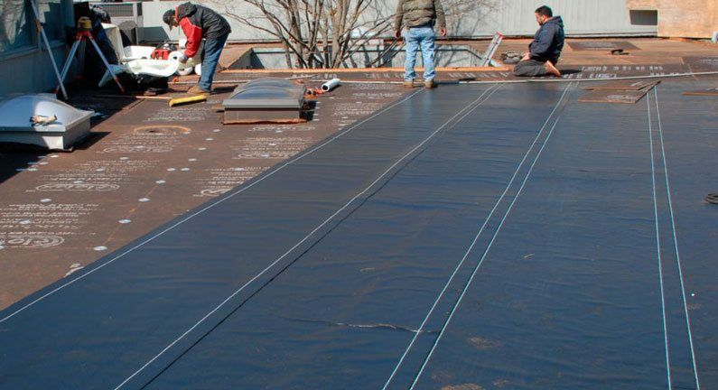 commercial residential rubber roofs- This is the installation of the First layer before Torching the final layer on top