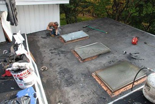 Skylight Repair - After cleaning the flashing on a skylight, it is time to install new flashing membrane over the copper flashing.