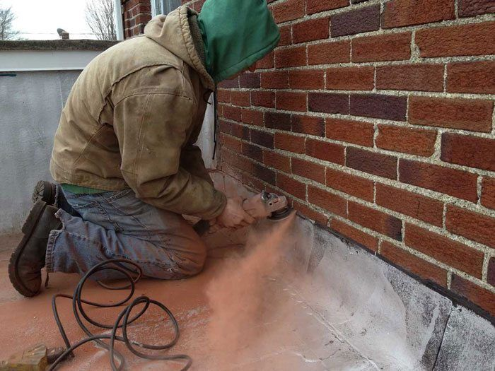 Harrisburg, Pennsylvania - Fixing a Flat Roof Installing Counter flashing - This is where a lo0t of flat roof leaks starts - Flashing is a very important part of a flat roof