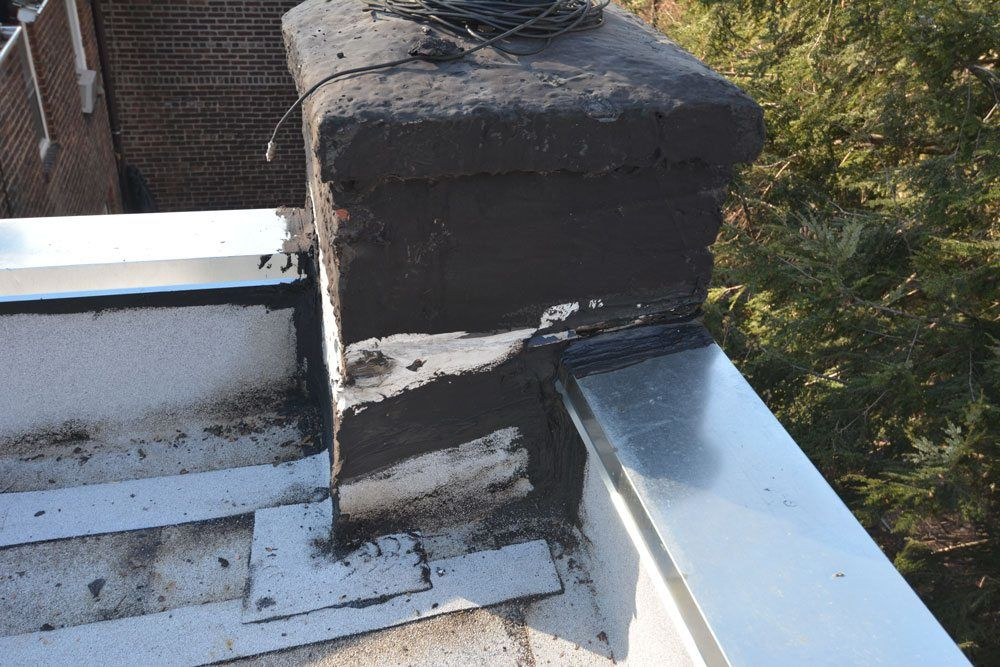 Chimney not properly flashed on a flat roof repair queens NY