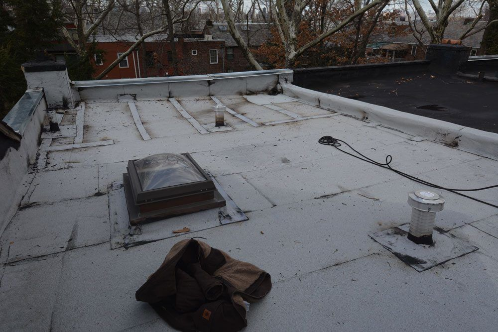 Skylight flashing on Flat roof repair in Queens NY