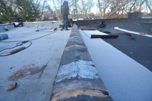 Parapet Wall prepared for rubber membrane cover - We removed the ridges on the clay cap - Queens NY